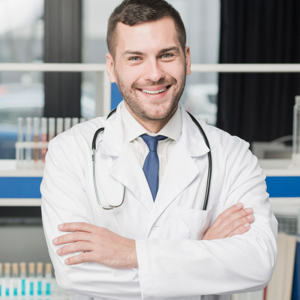 cropped-cheerful-medic-standing-with-arms-crossed.jpg